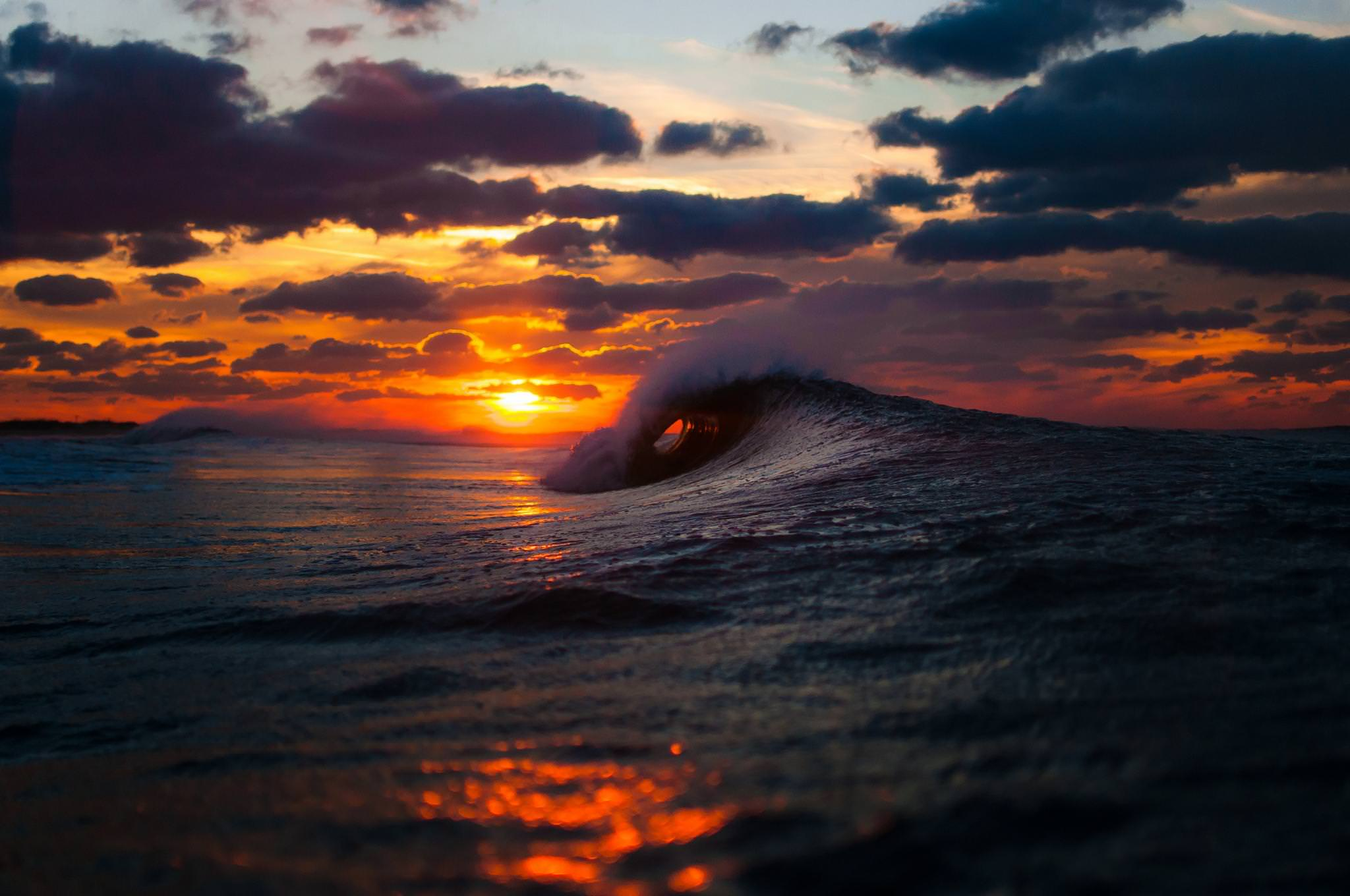 Sunset through the ocean waves