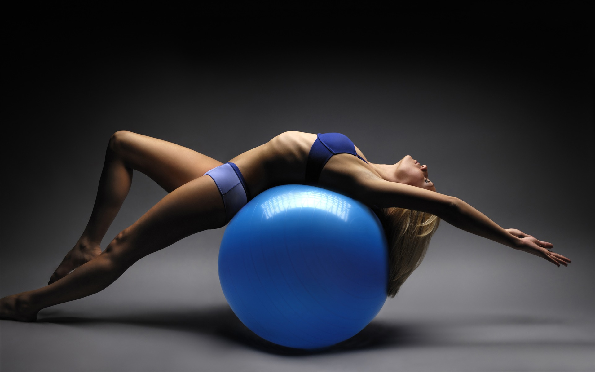 Girl training on gym ball photo wallpaper 1920x1200